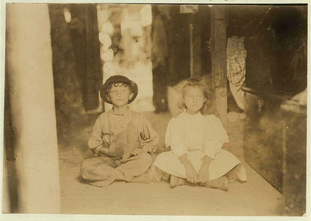 """No. 846-847. Name: These Children are representatives of the two families that occupy this one room in a shack on Bottomley's Farm, Baltimore, Md. There are only sliding curtains to separate families. Bunks on floor above. July 7, 1909."", 1909 - Lewis Hine - <i>Library of Congress</i>"